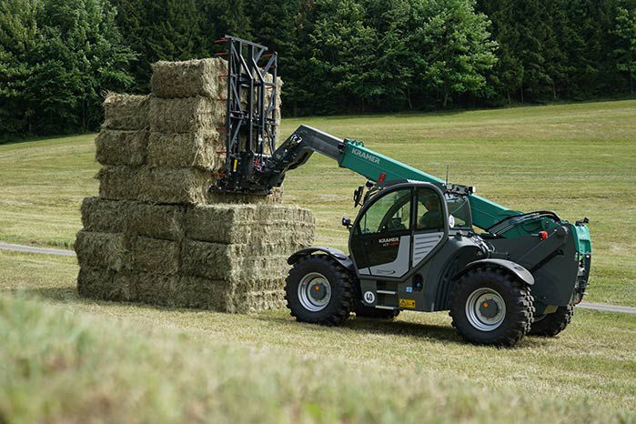 Kramer KT429 telehandler agriculture with fork and square hay bales