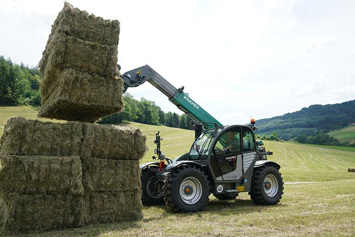 Kramer KT407 telehandler straw handling with three square hay bales