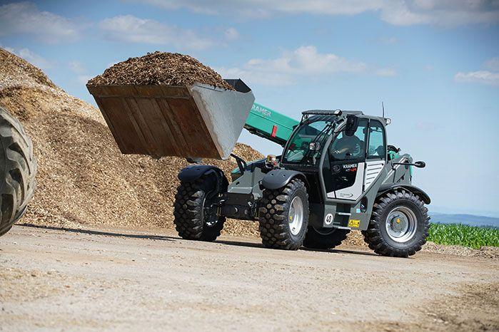 Kramer KT429 telehandler agriculture with filled bucket of wood chips